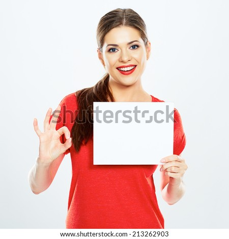 portrait of young woman holding sign card with O.K. symbol - stock photo