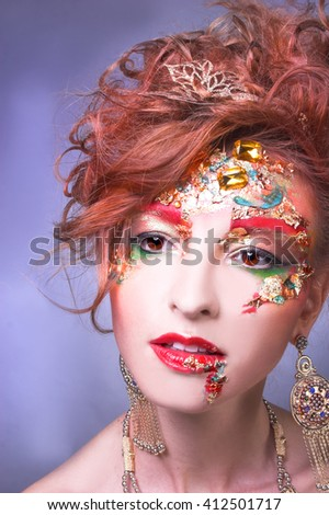 Portrait of young woman in artistic image - stock photo