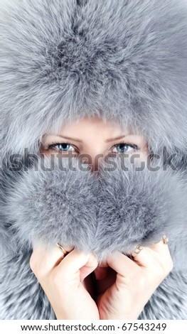 Portrait of young woman in furry hat - stock photo