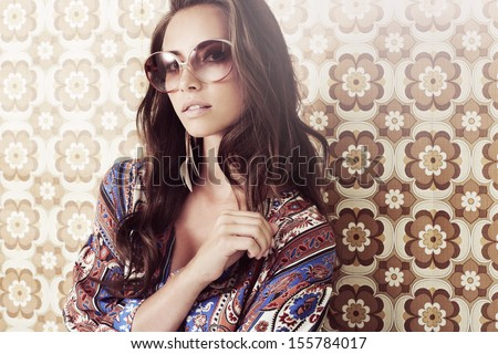 Portrait of young woman in 1970's fashion - stock photo