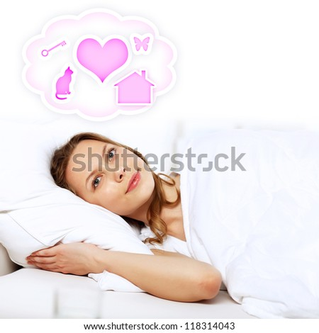 Portrait of young woman in white with heart symbols - stock photo