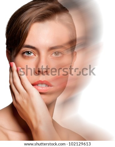 Portrait of young woman isolated on white background with a motion effect applied - stock photo