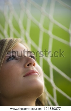 Portrait of young woman lying in hammock outdoors - stock photo
