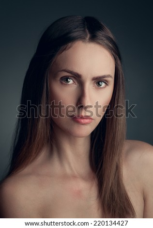 portrait of young woman on blue background - stock photo