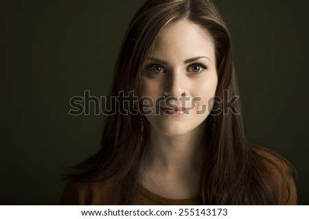 Portrait of young woman on green background - stock photo