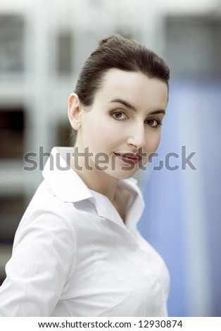 Portrait of young woman on modern office building enviroment background - stock photo
