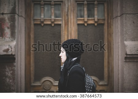 Portrait of young woman on the street - stock photo