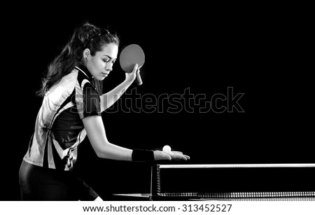 Portrait Of Young Woman Playing Tennis On Black Background with lights. Black and white. - stock photo
