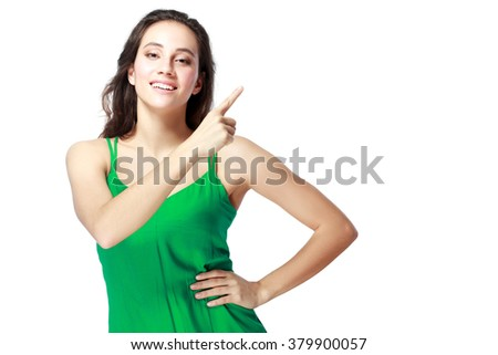 Portrait of young woman pointing her finger - stock photo