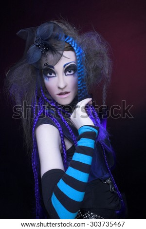 Portrait of young woman posing in gothic image. - stock photo