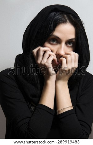 Portrait of young woman, scared, expressive pose - stock photo