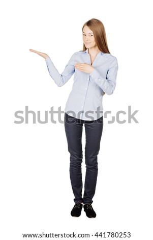 Portrait of young woman showing open hand palm with copy space for product or text. human emotion expression and lifestyle concept. image on a white studio background. - stock photo