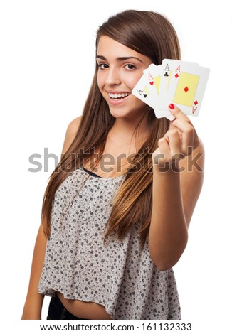 portrait of young woman showing poker cards isolated on white - stock photo