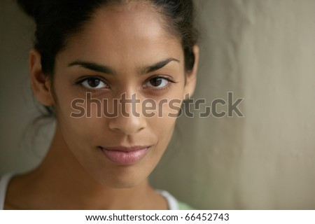 Portrait of young woman smiling - stock photo