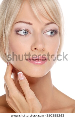 Portrait of young woman touching her face isolated on white background - stock photo