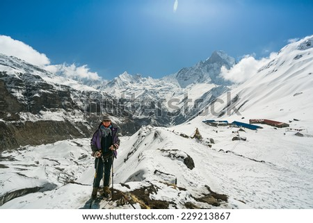 Portrait of young woman trekker. Annapurna base camp, Himalaya mountains, Nepal. - stock photo