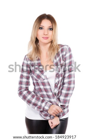 Portrait of young woman wearing checked shirt. Isolated on white - stock photo