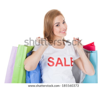 Portrait Of Young Woman Wearing Sale T-shirt Holding Shopping Bag - stock photo