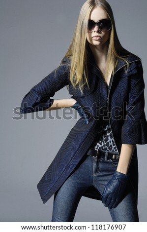 portrait of young woman wearing sunglasses posing - stock photo