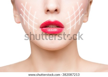 Portrait of young woman with arrows on her face - stock photo