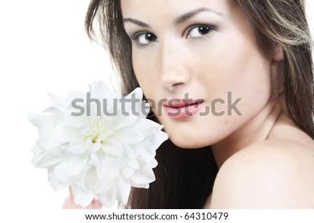 Portrait of young woman with beautiful make-up and white flower - stock photo