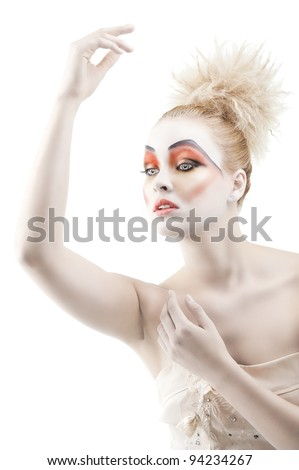 Portrait of young woman with colorful creative make-up like a doll and very cute hair style, she is turned of three quarters and looks at left, her left arm is reised up and she has the right hand - stock photo