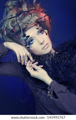 Portrait of young woman with creative visage and hairstyle. - stock photo