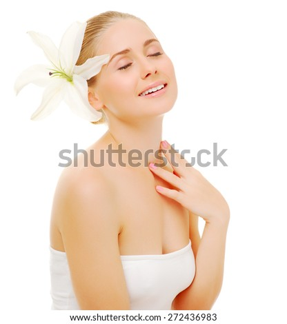 Portrait of young woman with flower isolated - stock photo