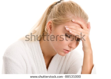 Portrait of young woman with headache - stock photo