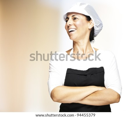 portrait of young woman with mesh top hat smiling indoor - stock photo