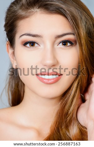 Portrait of young woman with natural make-up and beautful hair. Spa girl. Skincare, healthcare. Hair, haircare. Studio shot. - stock photo