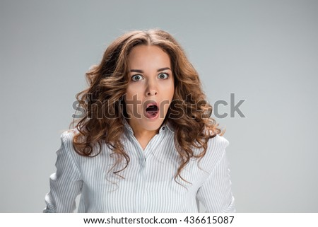 Portrait of young woman with shocked facial expression - stock photo