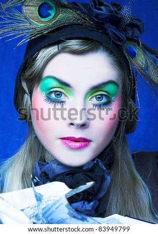 Portrait of young woman witn bright visage and with paper - stock photo