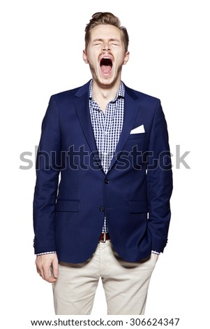 Portrait of young yawning man isolated on white background. Facial expression. - stock photo
