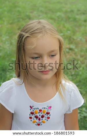 Portrait of younger schoolgirl with blond hair - stock photo