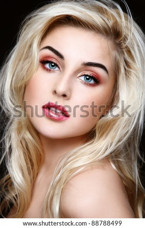 Portrait pf young beautiful girl with curly blond hair and stylish sparkly coral make-up - stock photo