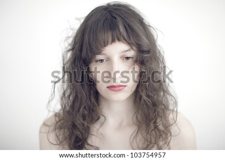 portrait photo of a sad and depressed young woman - stock photo