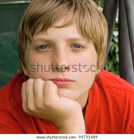 Portrait picture of a handsome young guy looking at the camera - stock photo