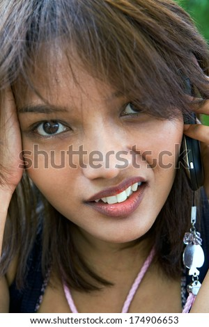 Portrait sad woman with cellular telephone - stock photo