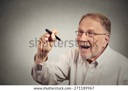 Portrait senior excited happy man writing something with pen on blackboard. Education concept  - stock photo