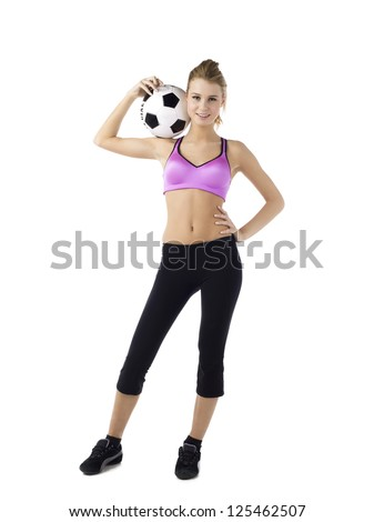 Portrait shot of a attractive young female carrying soccer ball on shoulder against white background - stock photo
