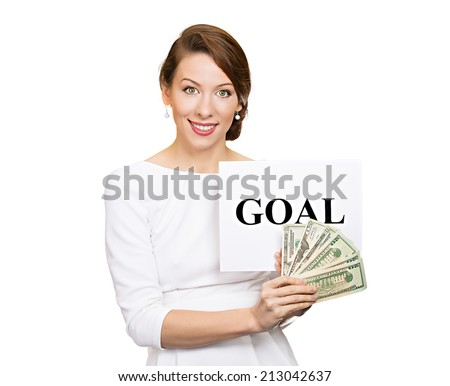 Portrait smiling, happy young businesswoman holding goal sign and cash, money isolated white background. Positive thinking, financial success, achievement concept. Face expression, life perception  - stock photo