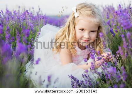 portrait smiling toddler girl in lavender field - stock photo