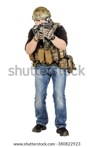Portrait  soldier or private military contractor holding black gun. war, army, weapon, technology and people concept. Image on a white background. - stock photo