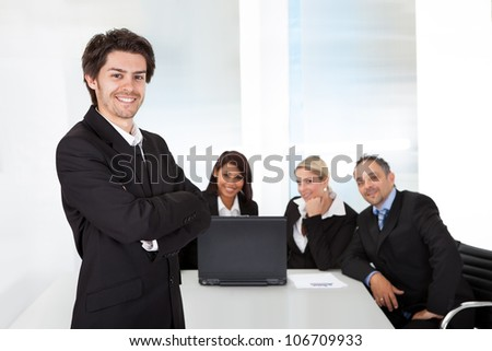 Portrait successful business man and his team - stock photo