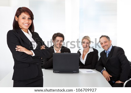 Portrait successful business woman and her team - stock photo