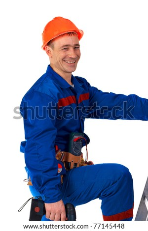 Portrait technician man in work wear with instrument and step-ladder - stock photo