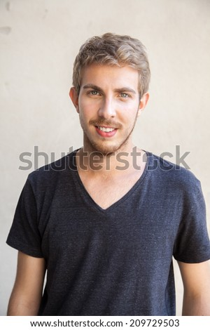 Portrait, twenty one year old man with green eyes and blond hair - stock photo