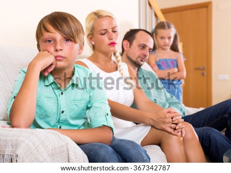 Portrait wailful little boy had quarreled with his parents at home - stock photo