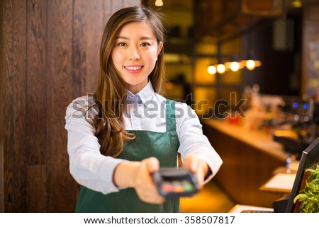 portrait waitress and waiter in cafe - stock photo